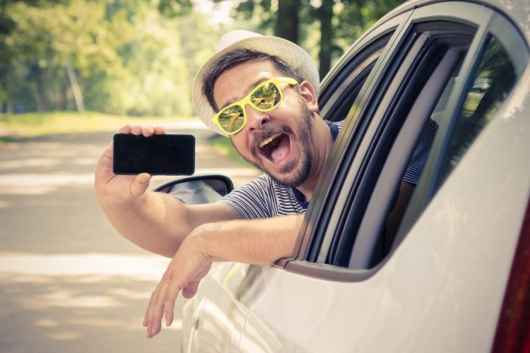 How does texting and driving effect auto insurance?